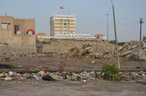 The new Iraq: an oil company building overlooks poverty-stricken slum in Basra...